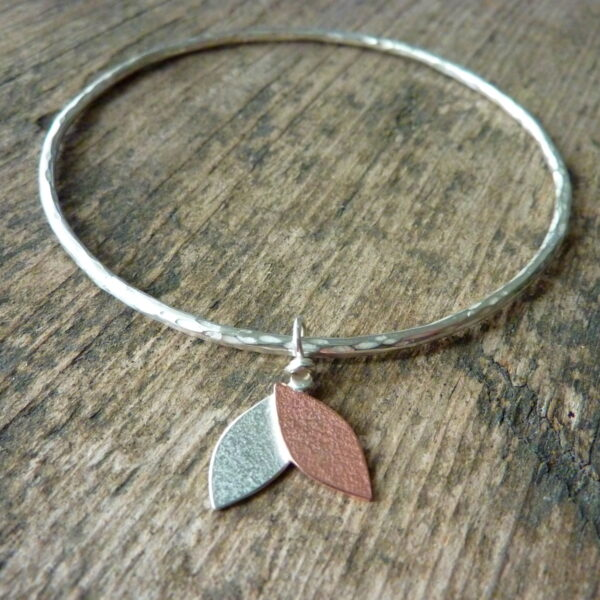 silver bangle with silver and copper leaf charm